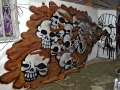 spray can puking skulls graffiti mural hire artist
