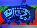 Styrofoam art piece mural uv black light reactive dinosaur skeleton fossil