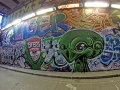 alien graffiti in London Leake Street tunnel