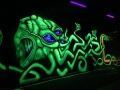 Vinni Kiniki black light graffiti green squid mural