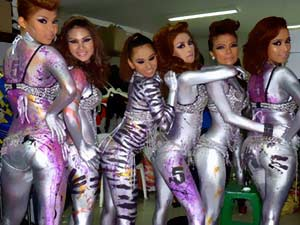 Body painting Thai coyote club podium dancers at Bangkok mega club