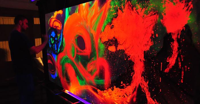 artist painting UV black light neon live painting