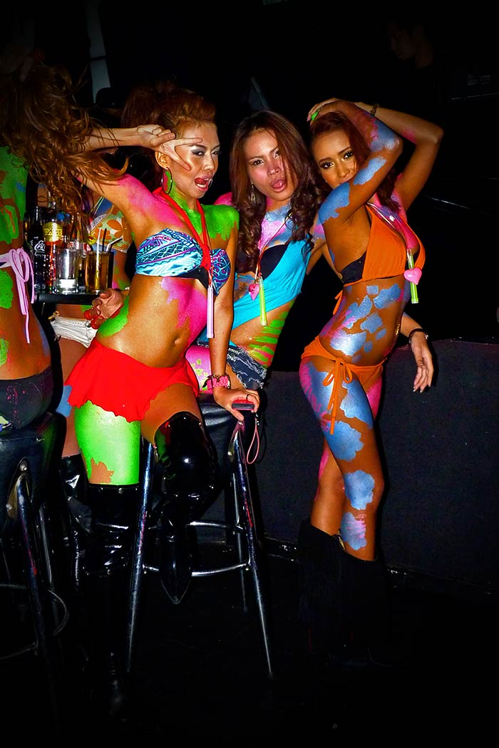 full moon party neon body painting coyote podium dancers at club insanity bangkok