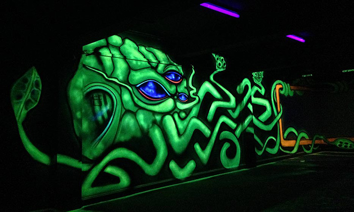 radioactive squid black light graffiti mural