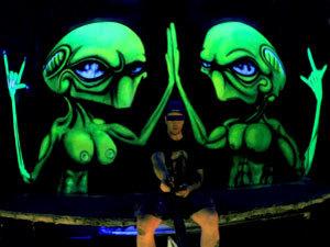 Black light alien graffiti on Bangkok art gallery