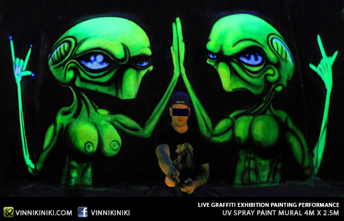 Black light alien graffiti art piece
