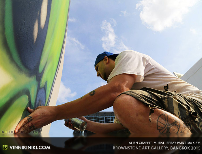 Graffiti artist painting in Bangkok