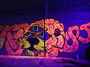 Black light graffiti art of an alien hybrid venom character