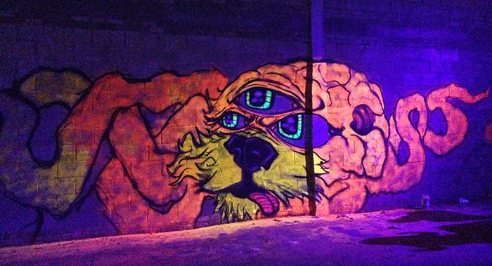 black light art mural of an alien hybrid creature