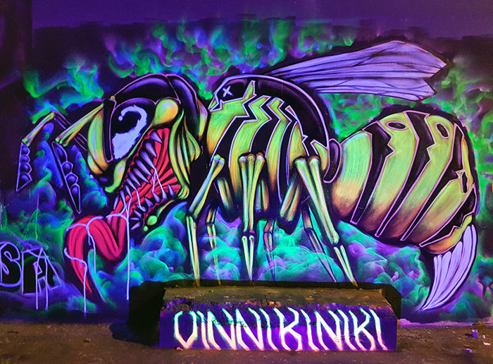 wasp venom mashup black light graffiti mural
