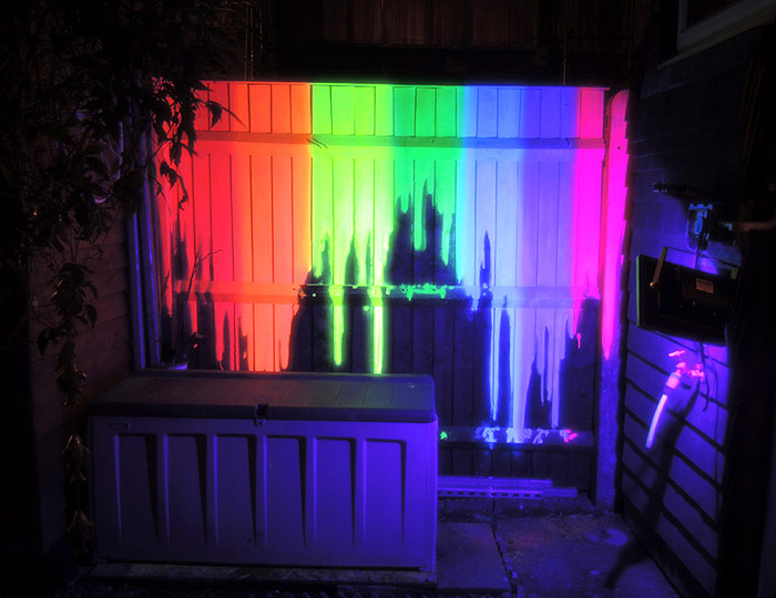 Black light neon dripping rainbow mural