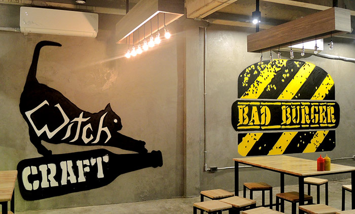 logo graffiti mural painted in craft beer and burger bar by vinnikiniki in bangkok