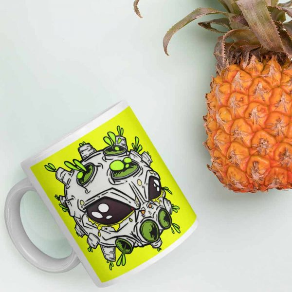 Alien virus conspiracy coffee cup next to a pineapple