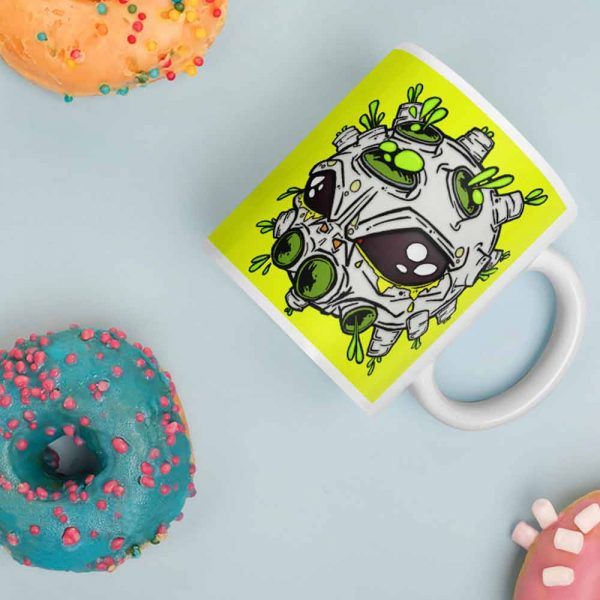 Alien virus conspiracy coffee cup next to doughnuts