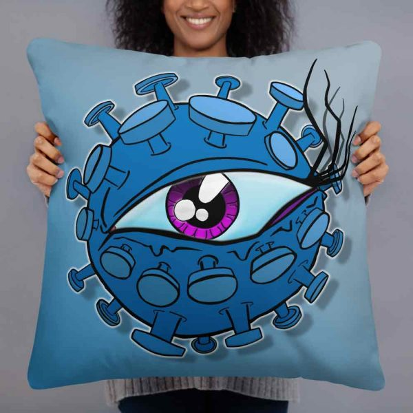 Woman holding a large blue eyeball virus pillow by Vinni Kiniki