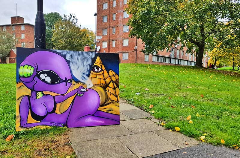 photo of painting of purple alien in London council estate Acton