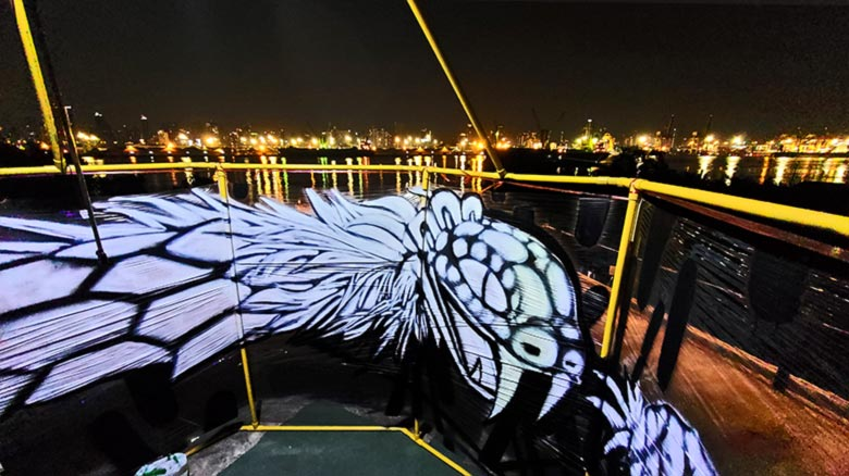 ouroboros serpent cellograff at night panoramic river view art installation